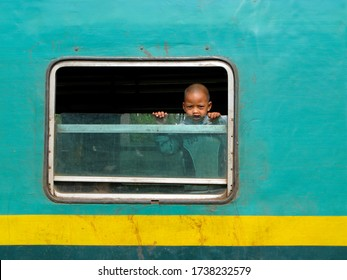MADAGASCAR, octobre 7, 2008: young kid inside the FCB train, the only railway in the country between Fiana and Manakara, he look outside the train through the window, Indian Ocean.