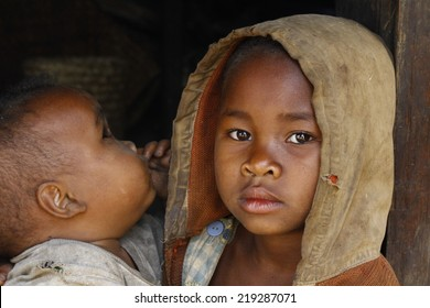 Madagascar-shy and poor african girl with child