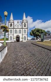 [Madalena, Pico, Azores - Aug 1 2018] Portugal, Azores, Pico Island, Madalena, harbor view with the Igreja de Santa Madalena church