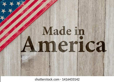 Made in America message, USA patriotic old flag on a weathered wood background with text Made in America