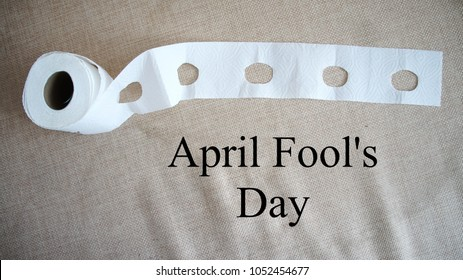 "the made a hole toilet paper, inscription ""April Fools' Day!!"""