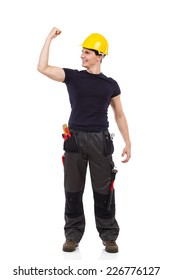 I made it! Shouting construction worker standing with one arm raised and flexing muscles. Full length studio shot isolated on white.