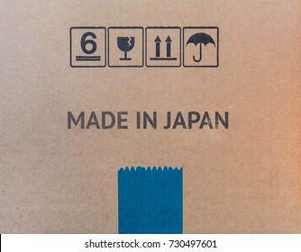 MADE IN JAPAN written on brown cardboard box.