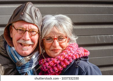 MADE, NETHERLANDS - FEBRUARY 11, 2018: Outdoor portrait of an unidentified elder man and woman with scarfs posing for the photographer; it is carnival in the village of Made, municipality of Drimmelen
