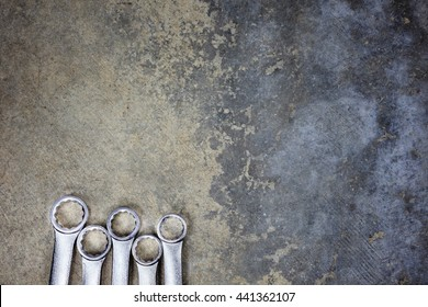 Made in the USA forged box end wrenches on a concrete garage floor.