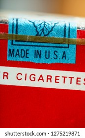 Made in USA label. Vintage packet of cigarettes produced in the USA. Banderole on top of the pack.  Red package. Close shot of filter cigarettes pack. US tax exempt for use outside USA.