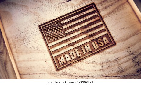 Made in USA symbol engraved on wooden board.