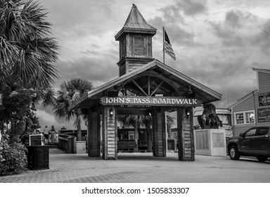 Madeira Beach, Florida USA 09/14/2019 John's Pass Village and Boardwalk sign on a Cloudy Rainy Day in Black and White