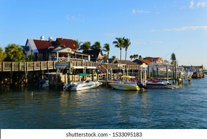 Madeira Beach, Florida, U.S.A - September 29, 2019 - The restaurants and boats on the dock by John's Pass and the canal