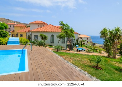 MADEIRA, PORTUGAL - AUG 27, 2013: swimming pool of luxury villa in hotel on coast of Atlantic Ocean. Madeira island is famous for best hotels in Portugal and for climate of eternal spring.