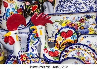 Madeira, Portugal - Feb 17, 2019: Madeira traditional souvenirs - cock figures.