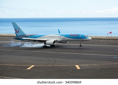 MADEIRA, PORTUGAL - NOVEMBER 02, 2015: Thomson Airways Boeing 737-800 on touch down at Funchal Airport