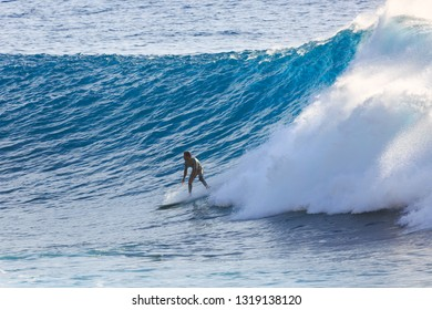 MADEIRA, PORTUGAL - OCTOBER 8, 2015: Surfer riding the big blue surf waves on the island Madeira, Portugal, a popular surfing tourist destination on October 8, 2015