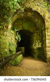 "Madeira, Portugal - September 2017: The entrance to the 800m long Rabacal tunnel on the levada walk to the 25 Fountains and Risco waterfall (""Levada das 25 Fontes e Cascada da Risco"")"