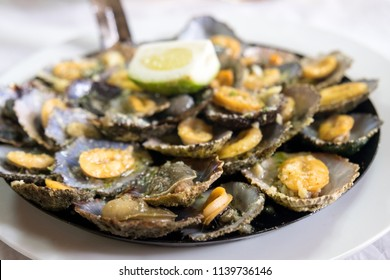 "A Madeiran speciality, the limpets ""Lapas"" are cooked in a frying pan of their own. The taste increases when splashed with fresh lemon and butter."