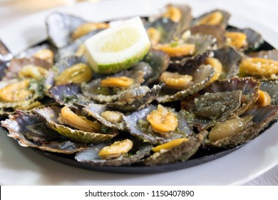 "A Madeiran specialty, the limpets ""Lapas"" are cooked in a frying pan of their own. The taste increases when splashed with fresh lemon and butter."