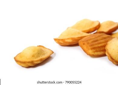 Madeleine cookies on white background