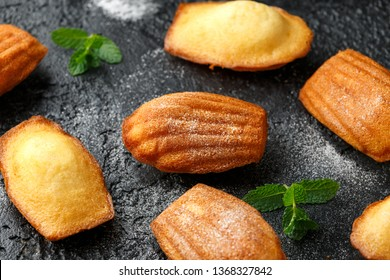 Madeleine French small cake, cookies shell on rustic background