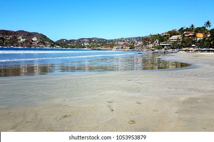 Playa Madera, the town of Zihuatanejo's most popular beach for locals, lies adjacent to the community.
