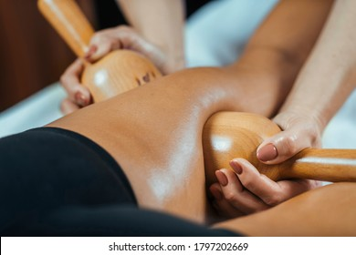 Maderotherapy anti cellulite massage treatment with wooden vacuum cup