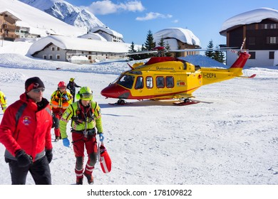 MADESIMO - FEBRUARY 22: Rescue helicopter evacuates skier after accident, Madesimo, Italy on February 22, 2014.