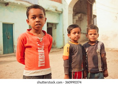 MADHYA PRADESH, INDIA - DEC 30: Unidentified poor children having fun on rural street of indian town on December 30, 2012. Madhya Pradesh is the 2nd largest Indian state, with 105,592 primary schools