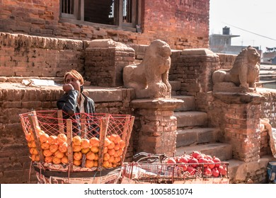 Madhyapur Thimi, Bhaktapur District, Nepal. 16 December 2017.  Nepalese man selling the fruits in front of the temple.