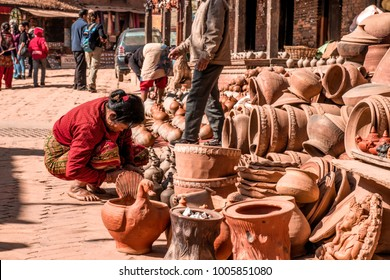 Madhyapur Thimi, Bhaktapur District, Nepal. 16 December 2017. Nepalese woman drying raw clay pot on her workshop.