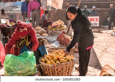 Madhyapur Thimi, Bhaktapur District, Nepal. 16 December 2017. Nepalese woman selling and buying fruit in the local market.