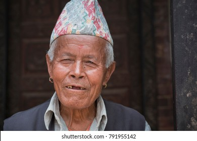 Madhyapur Thimi, Bhaktapur District, Nepal. 4 Jun 2017. Documentary. A portrait of an unidentified nepalese elderly man wearing traditional hat.
