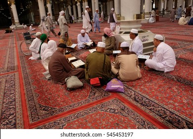 MADINAH, KINGDOM OF SAUDI ARABIA- November 30 : A group of muslims learning Al-Quran at Nabawi Mosque on Nov 30, 2016. Nabawi mosque is the second holiest mosque in Islam.