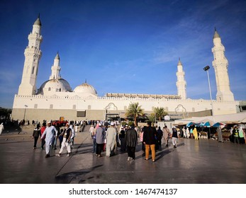 Madinah, Saudi Arabia - 01 August 2019; Beautiful view of Quba Mosque with muslim pilgrims walk for prayer.