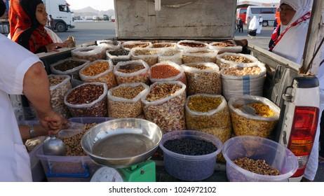 Madinah, Saudi Arabia - circa March 2017: Peddlers selling dates and nuts at a mosque near Madinah Al-Munawwarah during umrah pilgrimage.