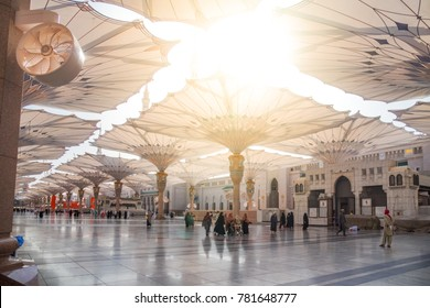 MADINAH, SAUDI ARABIA - DEC 2017 : Muslim pilgrims visiting the beautiful Nabawi Mosque, the Prophet mosque which has great architecture during umrah season