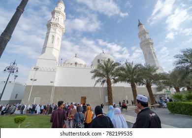 MADINAH, SAUDI ARABIA - DEC 2017 : Muslim pilgrims visiting Quba Mosque during umrah season. It's the oldest mosque in the world