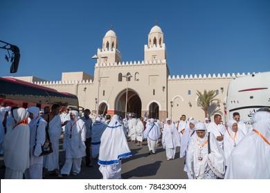 MADINAH, SAUDI ARABIA - DEC 2017 : Muslim pilgrims visiting Bir Ali Mosque for Miqat, wearing Ihram clothes during umrah season