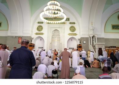 MADINAH, SAUDI ARABIA -September 1 2018 : Muslims pray inside Masjid Quba  in Medina, Saudi Arabia. This is the first mosque built by Prophet Muhammad (pbuh) in Islam.