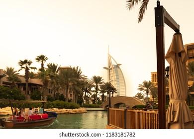 Madinat Jumairah, Dubai, United Arab Emirates- August 24th 2018: evening boat rides in Jumairah lakes. Burj Al Arab building is in the vicinity.