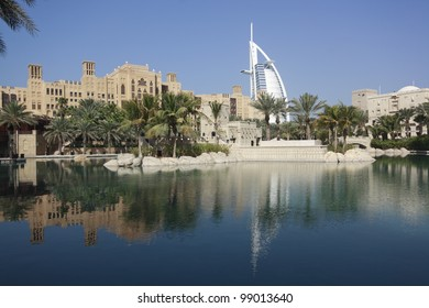 Madinat Jumeirah and the Tower of Arabs (Burj Al Arab) in Dubai reflecting in an artificial pool.