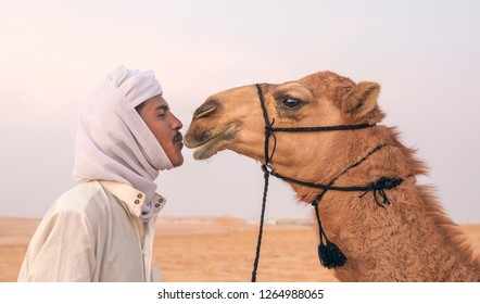 Madinat Zayed, United Arab Emirates, 21st December 2018: Sudanese man kissing his camel