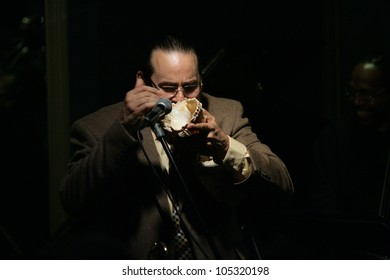 MADISON, NJ - JUNE 16: Steve Turre changes pitch by moving his hand in and out of a conch seashell as he performs with his Quartet at Shanghai Jazz on June 16, 2012 in Madison, NJ.