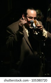 MADISON, NJ - JUNE 16: Steve Turre adjusts pitch by moving his hand in and out of a conch seashell as he performs with his Quartet at Shanghai Jazz on June 16, 2012 in Madison, NJ.
