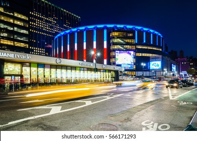 Madison Square Garden, New York, USA - 17 October, 2016: Illuminated stadium with car riding around.