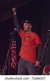 MADISON, WI - FEB. 21: Tom Morello, The Nightwatchman, performs at the Monona Terrace in Madison, WI on February 21, 2011 to rally for worker's rights in an anti-Walker protest.