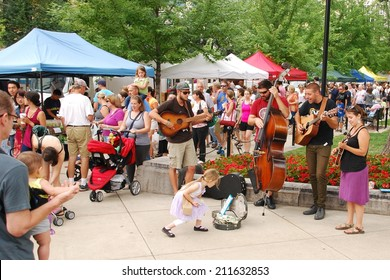 "MADISON, WI - JULY 26th, 2014:  Colorado music act ""Rich With Friends"" performs outside the Wisconsin State Capitol building during a regular Saturday Farmer's Market."