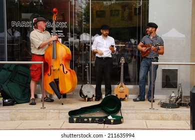 MADISON, WI - JULY 26th, 2014:  The State Capitol square in Madison is the venue for many public gatherings.  Here, musicians take a break during a performance at a Summer Saturday Farmer's Market.