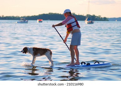 MADISON, WI - JULY 3rd, 2014: Candidate for Wisconsin Brett Hulsey campaigns at the University of Wisconsin's Memorial Union Terrace.  Paddle boarding with his dog Penny gathers lots of attention.