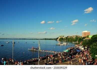MADISON, WI - JUNE 20th, 2014: Many people gather for the annual Isthmus Jazz Festival.  The festival occurs at the University of Wisconsin Memorial Union Terrace on Lake Mendota as shown here.