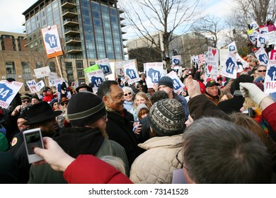 MADISON, WI - MAR 12: Crowds cheer for Rev Jackson at a rally on March 12, 2011 in Madison, Wisconsin. The rally was held to welcome back democrats who fled the state to prevent a vote on collective bargaining rights.