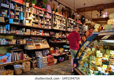 Madison, WI USA. Jul 2018. Assorted amount of meat, cheese, sweets, sauces, spices, alcohol, and many more food products, including local craft works inside the Fromagination.